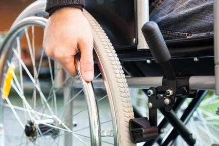 Close up of hand on wheelchair