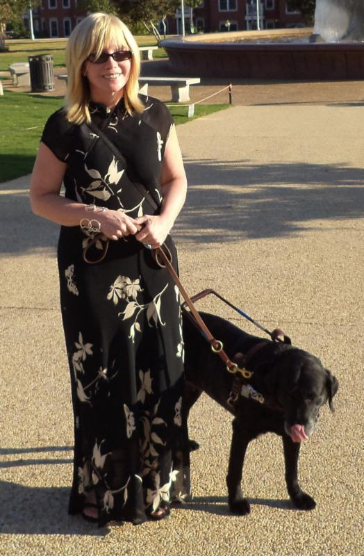 Cecilia in black dress with guide dog