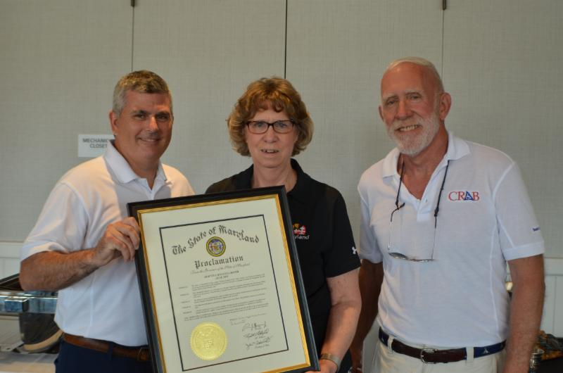 Secretary Beatty presents proclamation making June Accessible Boating Month in MD.