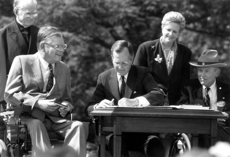President Bush signing ADA into law as advocates and lawmakers look on