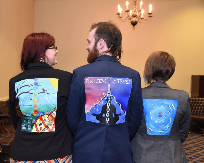 back of three jackets with painting