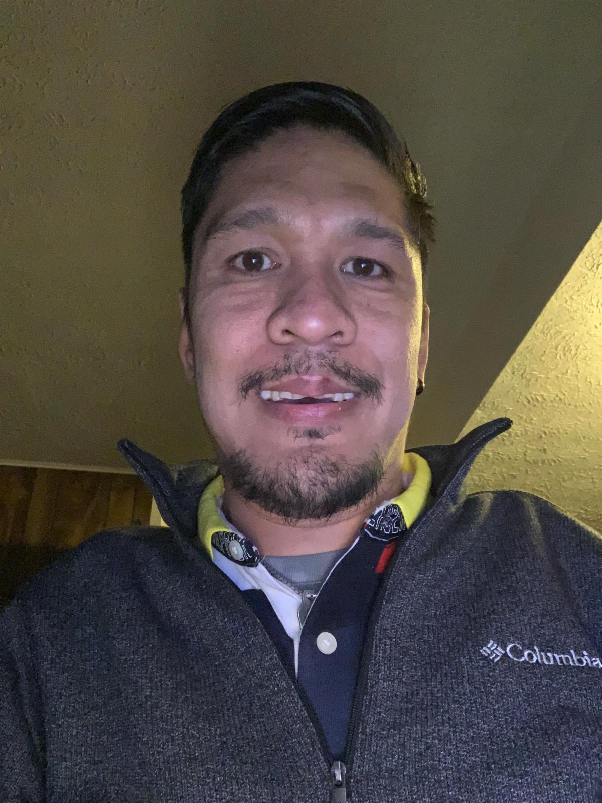 Close up of Bong DelRosario.  He is wearing gray pullover.