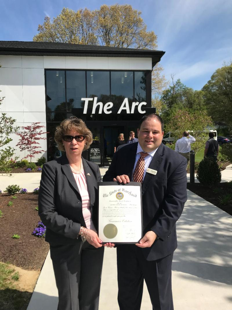 Sec Beatty holds Governor_s Citation with Jonathan Rondeau