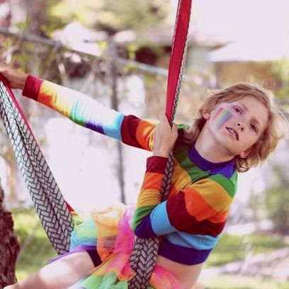 Bink a gender non-conforming child plays on a hammock