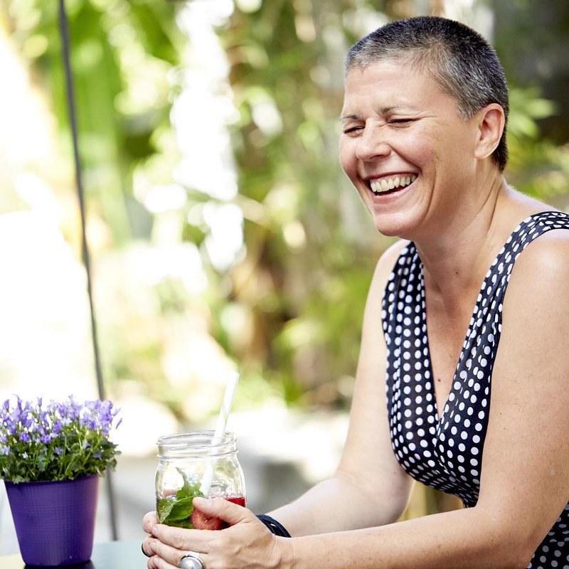 Diane smiling in polka dot dress