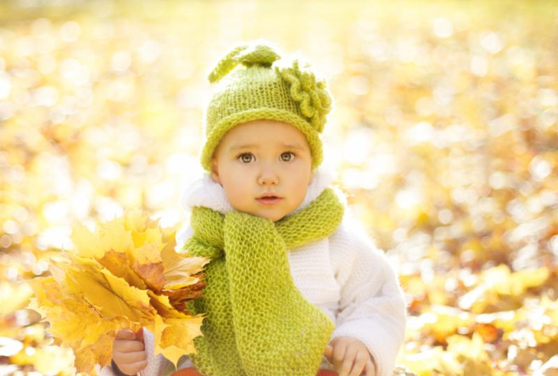 baby_in_fall_leaves.jpg