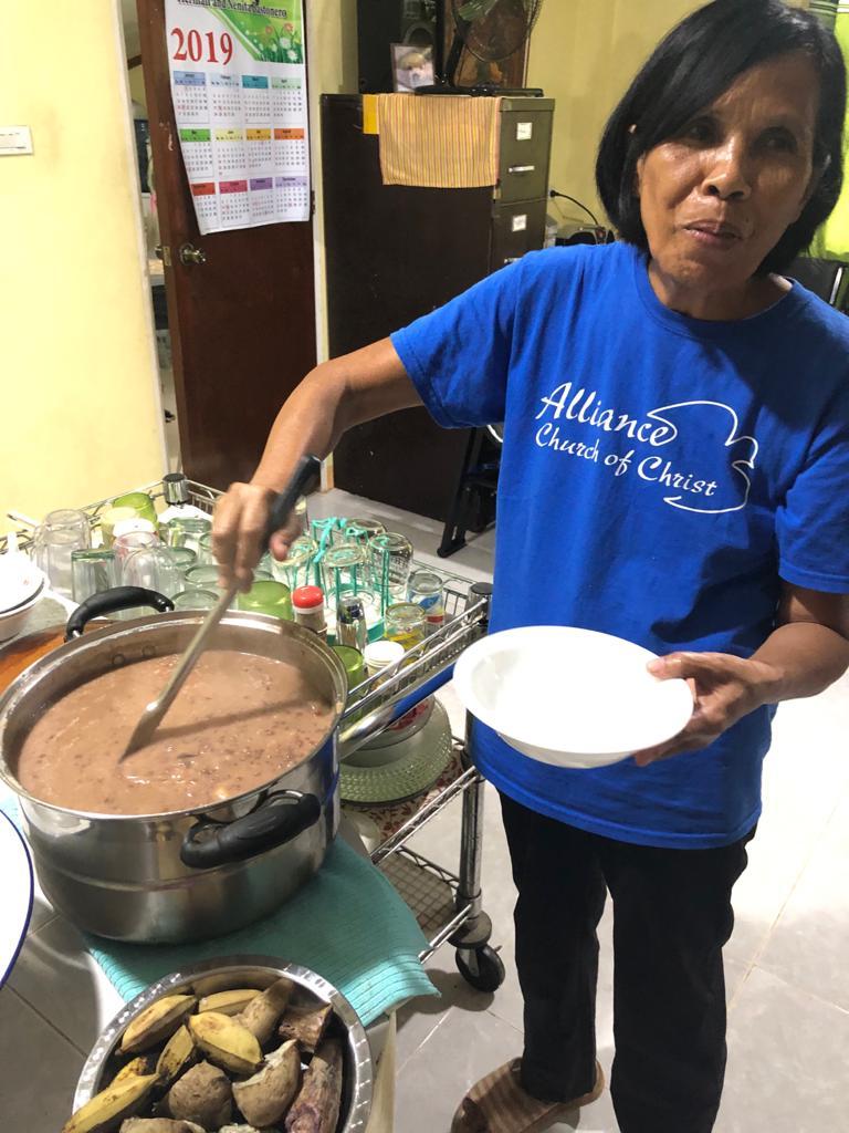 Nanay serving us ginataan.