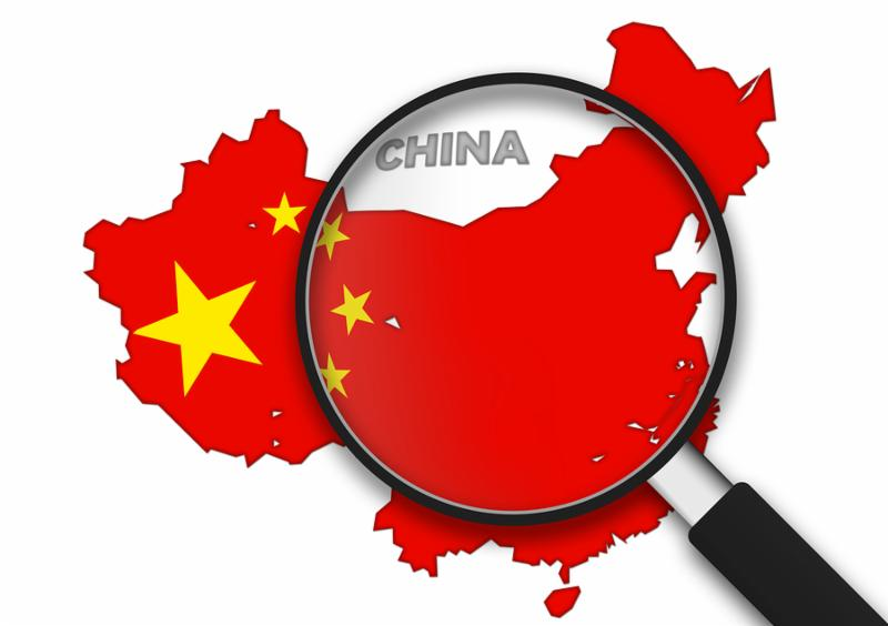 Magnifying Glass with the China country Map on white background.