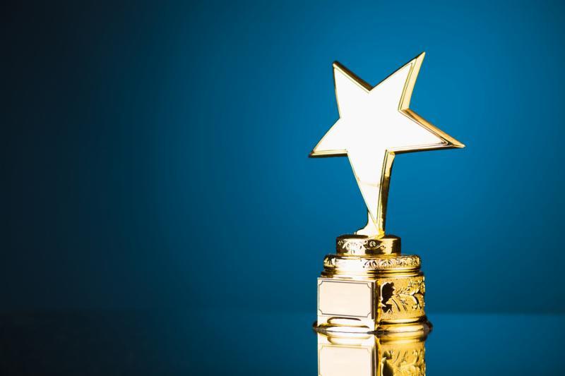 gold star trophy against blue background