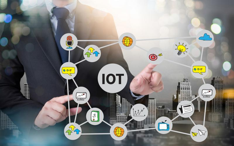IOT business man hand working and internet of things  IoT  word diagram as concept and businessman working with modern technology