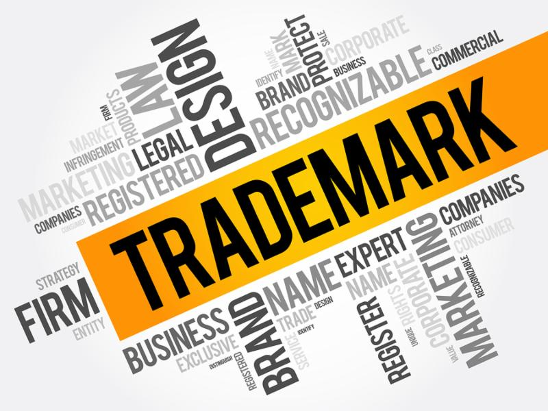 Trademark word cloud collage business concept background