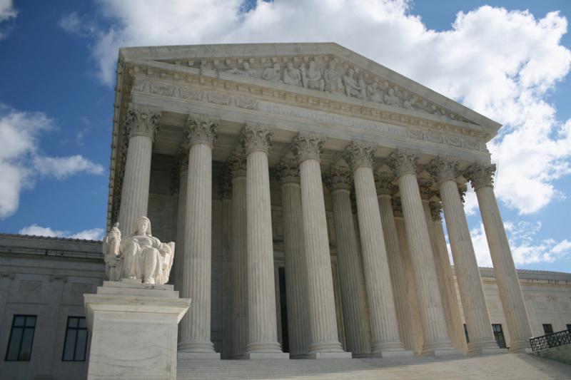 statue outside front of Supreme Court Washington DC