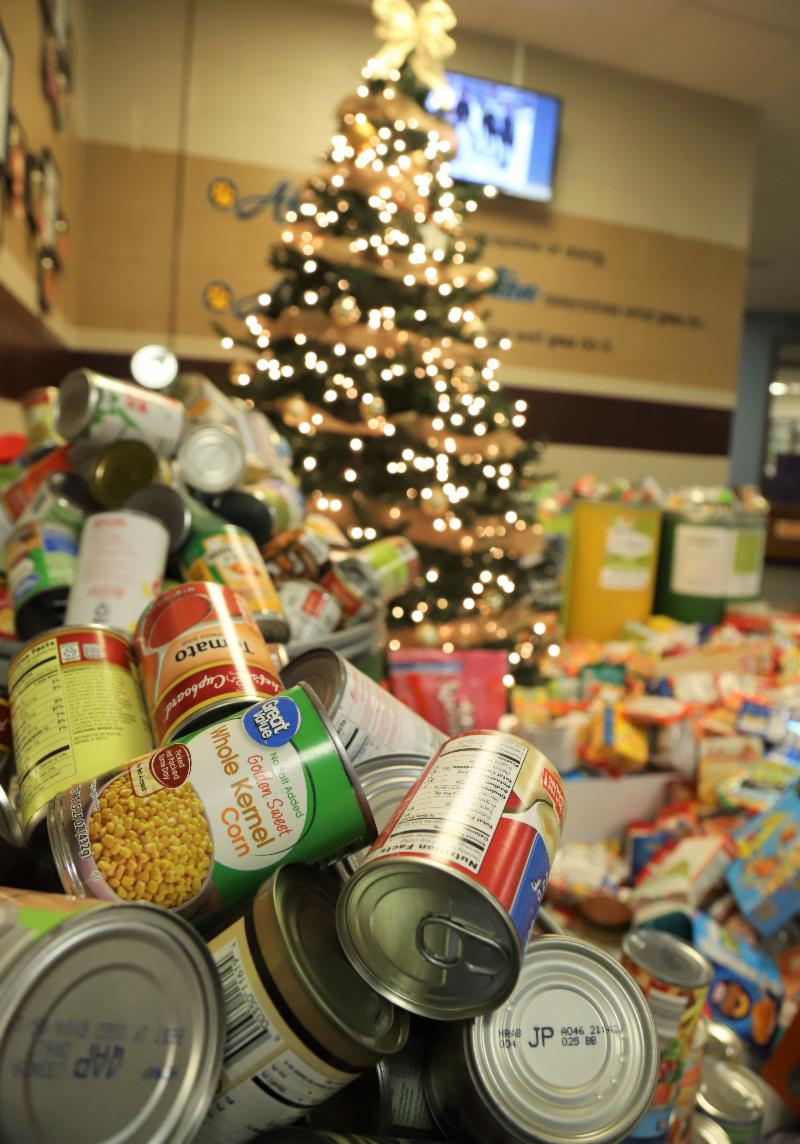 Food piled up by Christmas tree