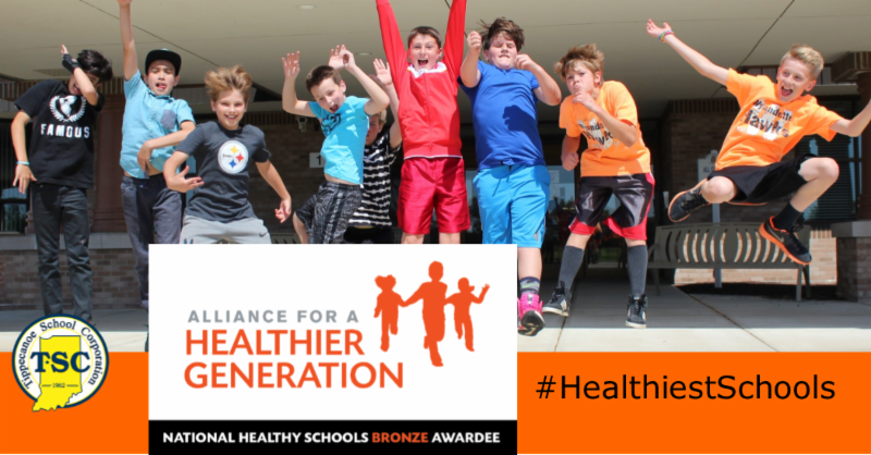 students jumping with sign for Alliance for Healthier Generation