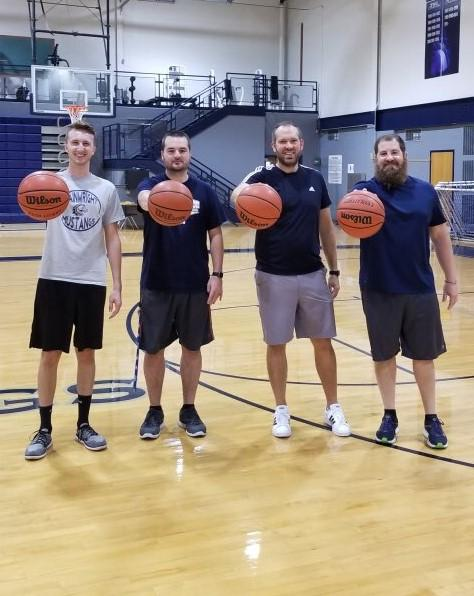 group of teachers playing basketball