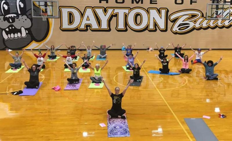 group stretching on Dayton gym floor