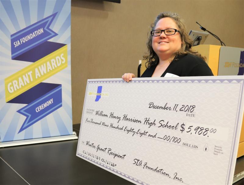 Jennifer Tordil holding her grant check
