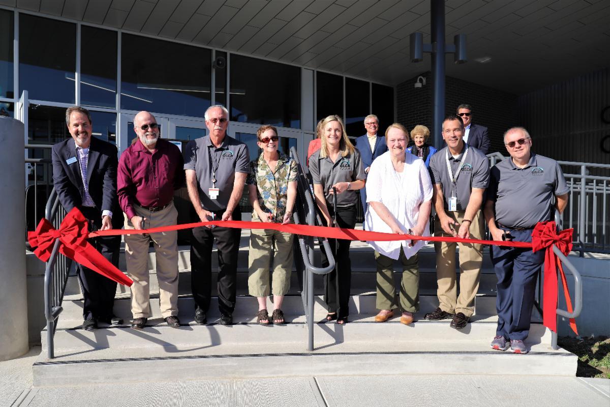 School and community leaders cutting ribbon