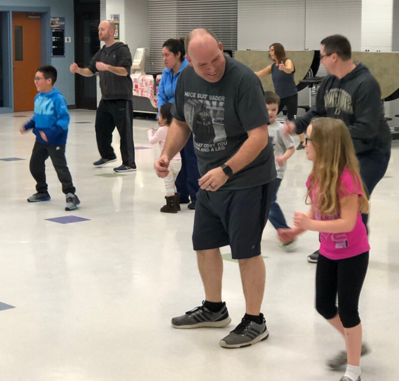 Parents and students exercising