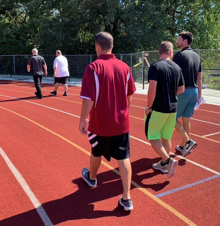 employees walking around track