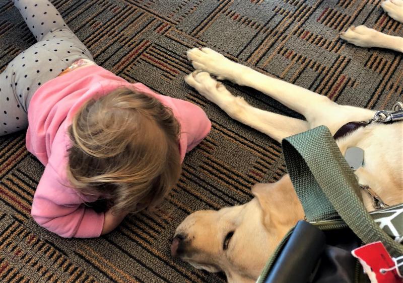 Little girl on floor with Nacho