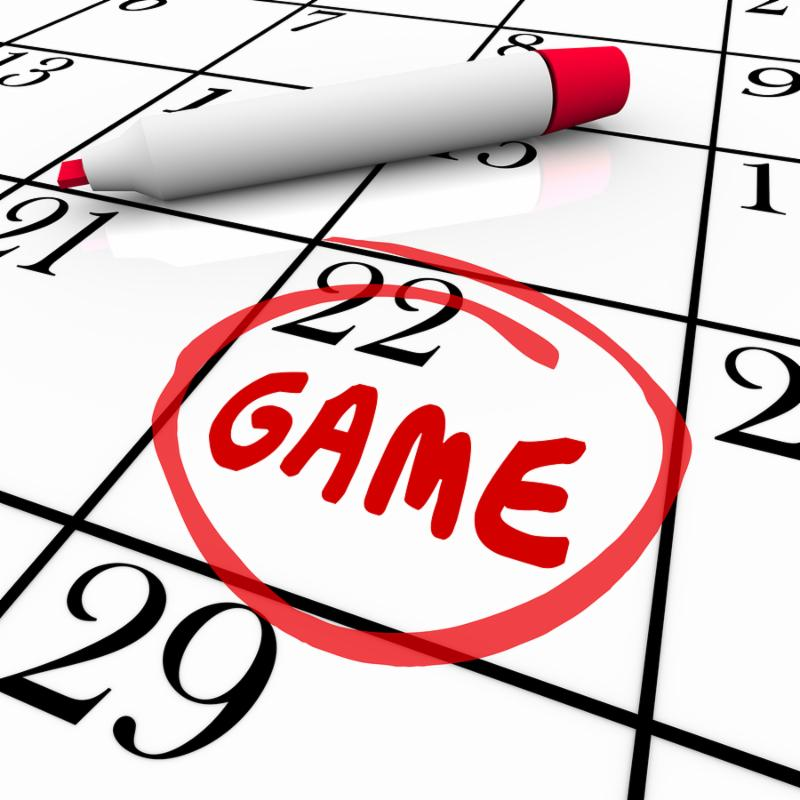 Game day or date circled with red pen or marker on a calendar or schedule as a reminder of the big event or competition