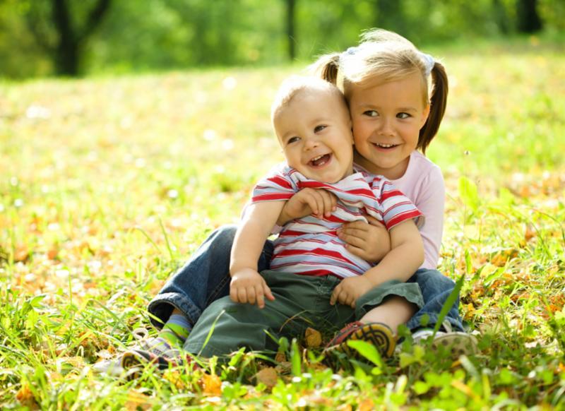 kids_hugging_on_grass.jpg