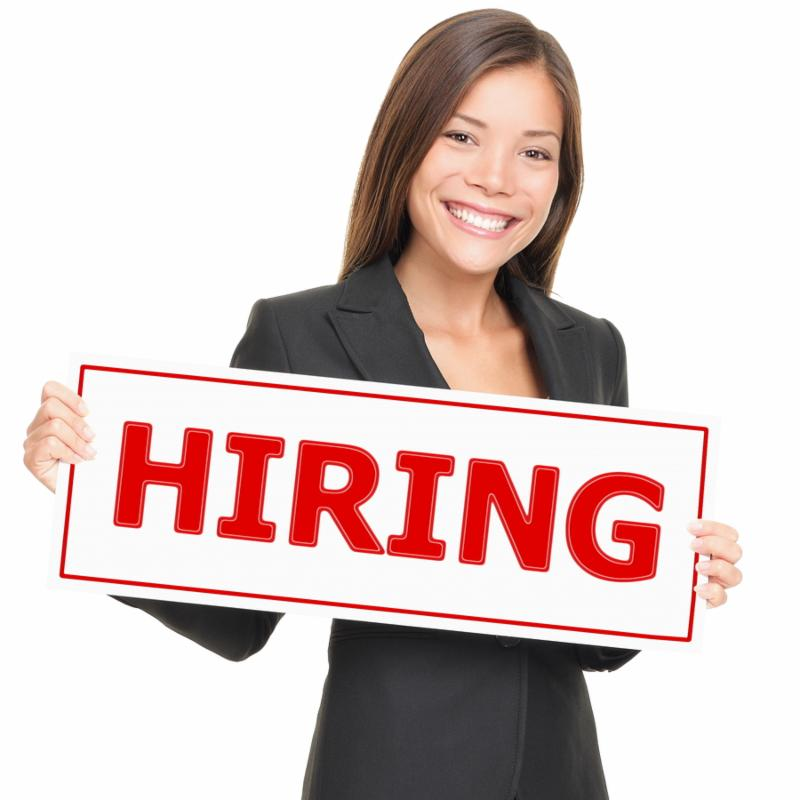 Job woman showing hiring sign. Young smiling Caucasian   Asian businesswoman isolated on white background.