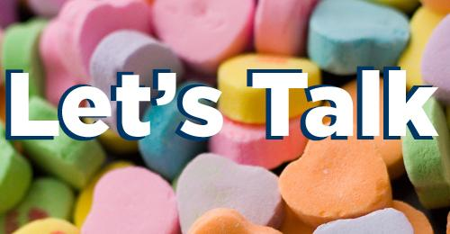 conversation hearts with the words Let_s Talk