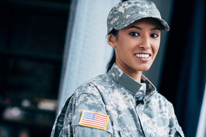 bigstock-Soldier-With-Usa-Flag-Emblem-213740980-700x467.jpg