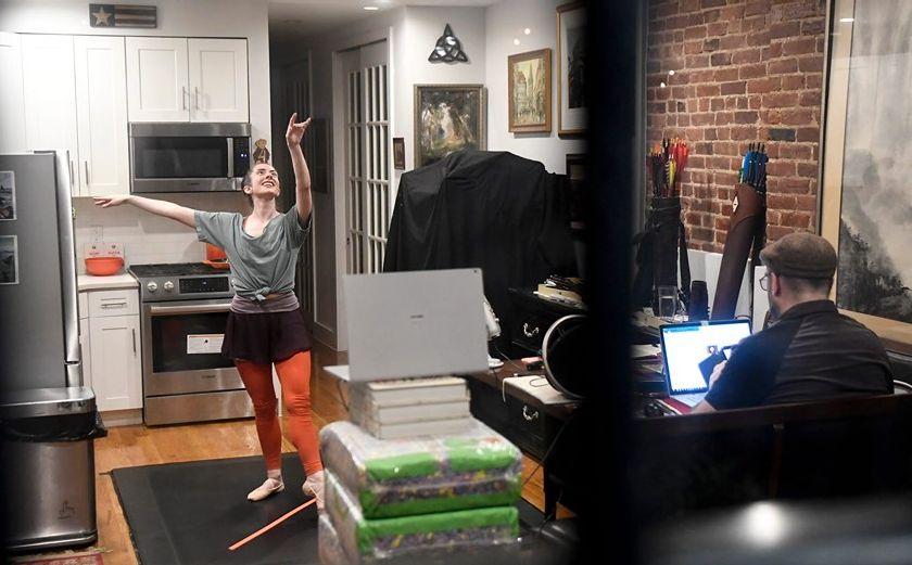 Ballet dancer being filmed dancing in apartment