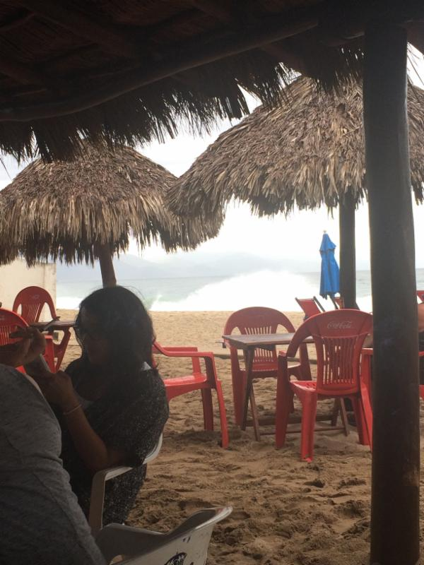 Under a palapa in the rain