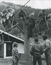 Vintage photo: CMC ski area operations students working on a lift tower.