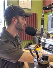 Photo of Lucas Turner working at radio station. Photo by Will Grandbois, Sopris Sun.
