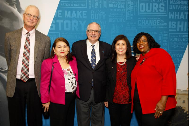 CPS employees recognized at Career Milestones event with GW President (center)