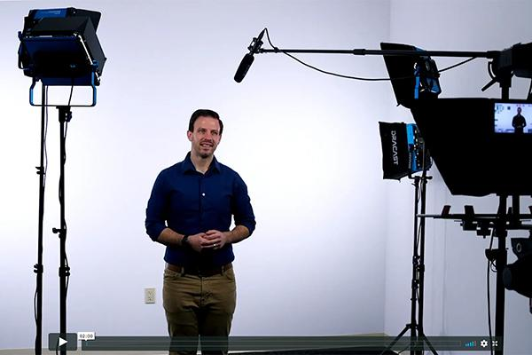 Drew Santorello in video production studio at GW