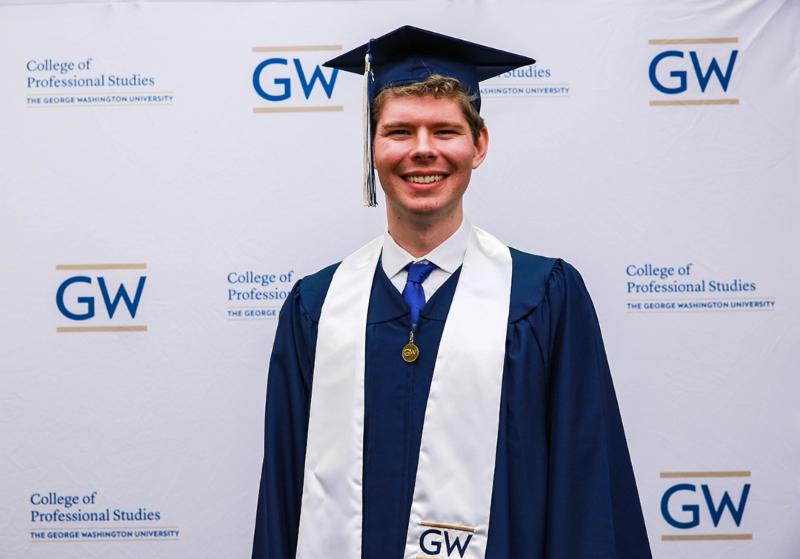 Cameron Peters Cyber BPS graduate in cap and gown