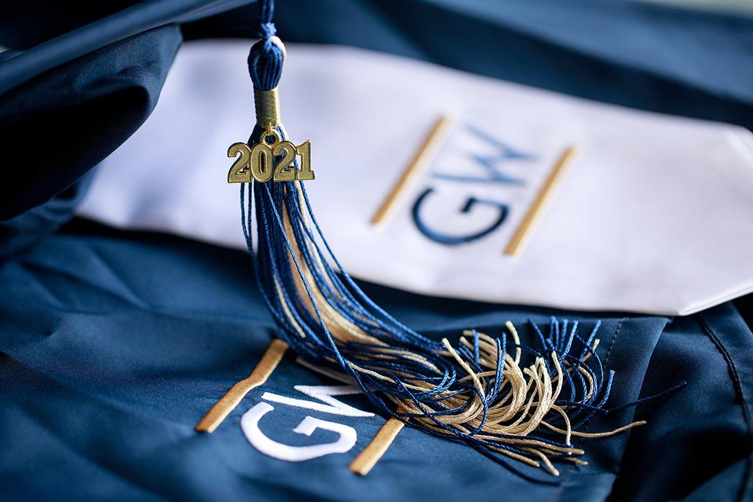 GW logo embroidered on cloth with 2021 commencement tassle in blue and buff