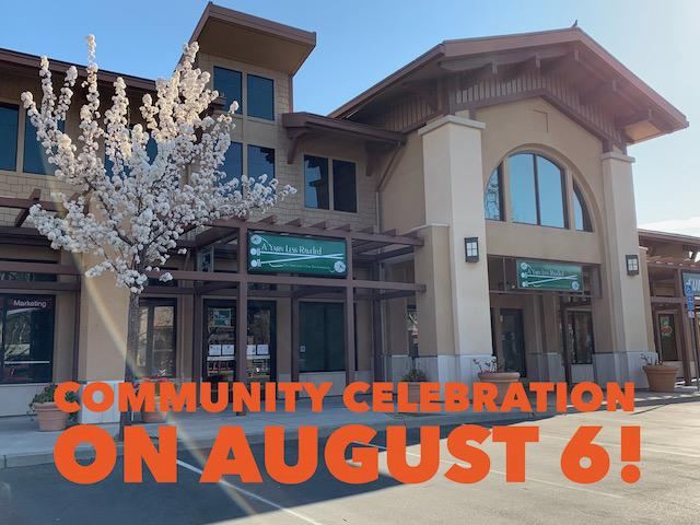 Shopfront with words Community Celebration on August 6