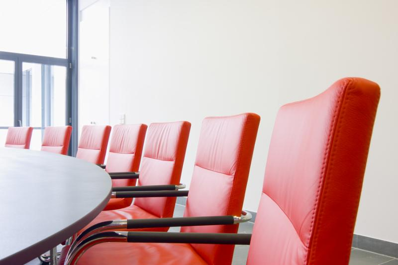 Red leather chairs in a conference room