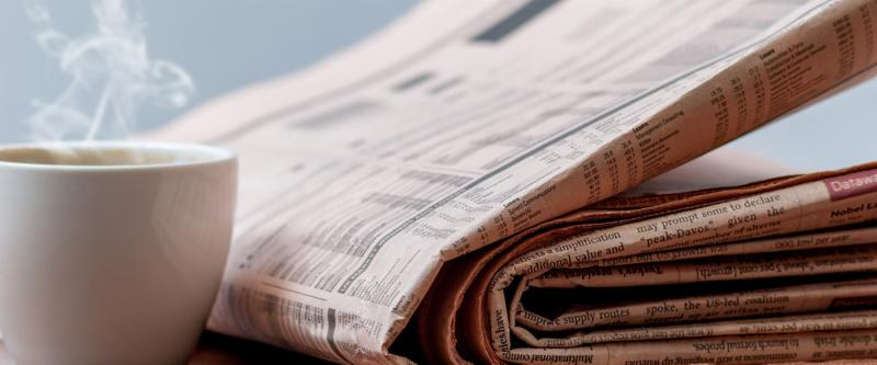 Image of newspaper and coffee cup