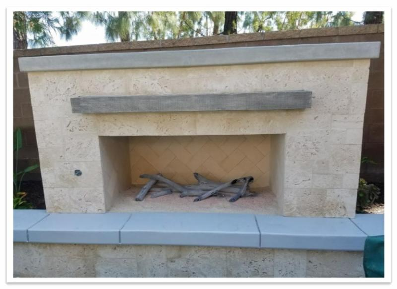 Outdoor fireplace with Custom Reclaimed Mantel