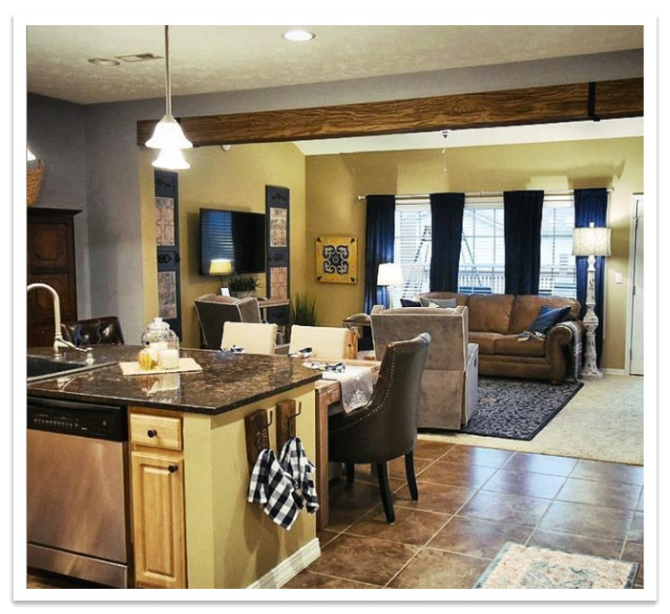 Heritage beam dividing a kitchen_living room