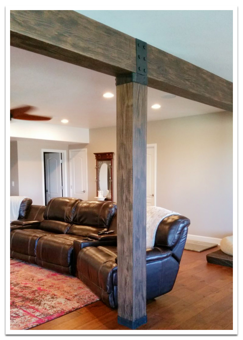 Basement lally column covered with a Resawn beam
