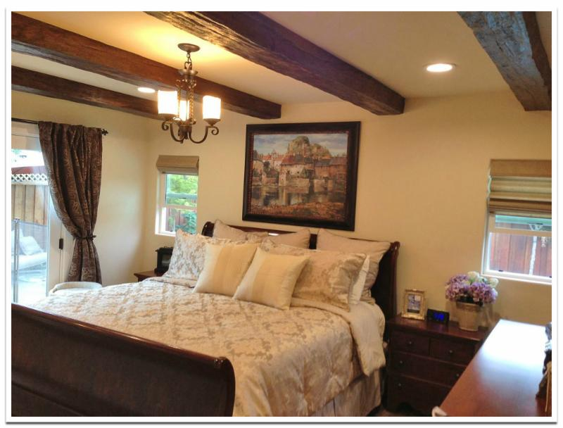 Bedroom with Custom Timber beams