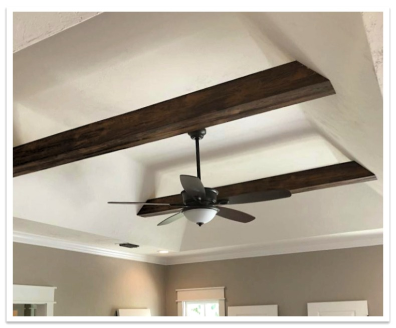 Suspended beams on a bedroom_s tray ceiling