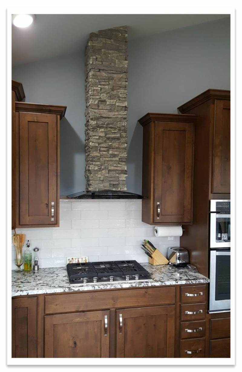Stove hood with Norwich Stacked Stone column