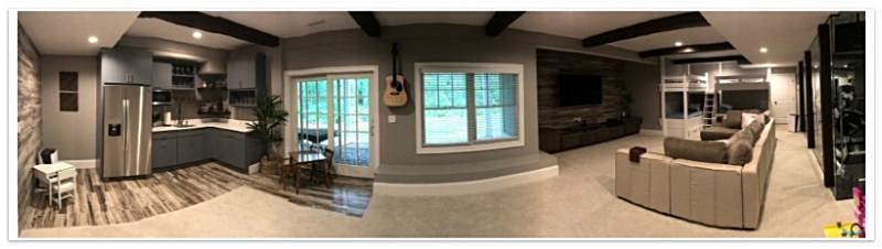 Finished basement with Woodland beams
