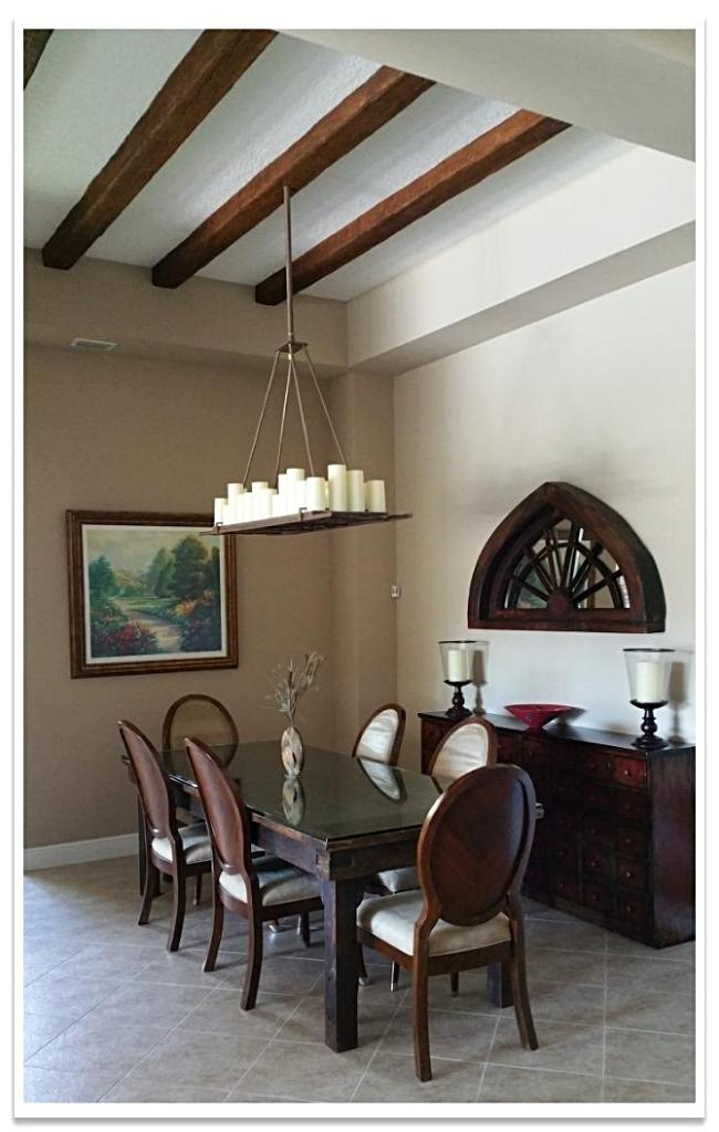Dining room with Timber beams and candle chandelier