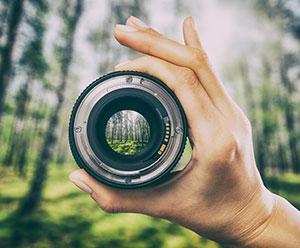 Holding a camera lens